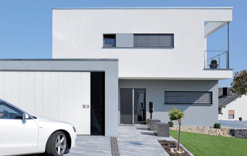 Porte de garage coulissant latéral